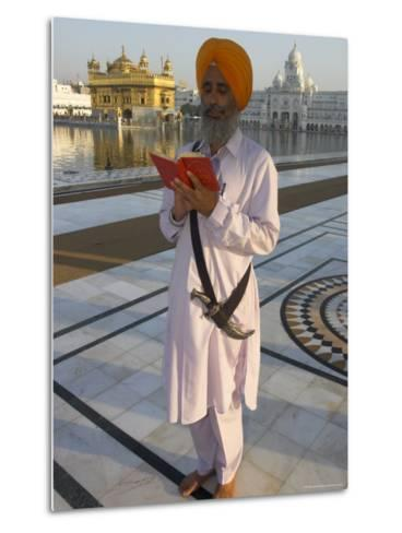 Sikh Pilgrim with Orange Turban, White Dress and Dagger, Reading Prayer Book, Amritsar-Eitan Simanor-Metal Print