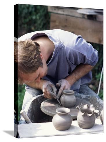 Potter at Work on Wheel at Rustic Fayre, Devon, England, United Kingdom-Ian Griffiths-Stretched Canvas Print