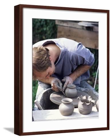 Potter at Work on Wheel at Rustic Fayre, Devon, England, United Kingdom-Ian Griffiths-Framed Art Print