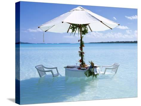 White Table, Chairs and Parasol in the Ocean, Bora Bora (Borabora), Society Islands-Mark Mawson-Stretched Canvas Print