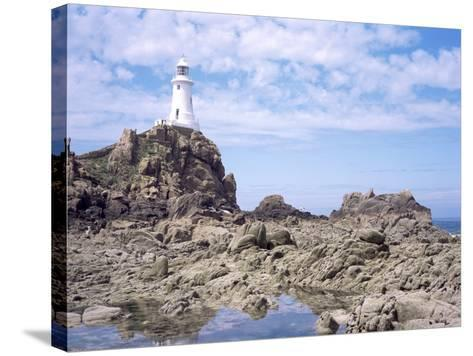 Lighthouse from the Causeway at Low Tide, Corbiere, St. Brelade, Jersey, Channel Islands-David Hunter-Stretched Canvas Print