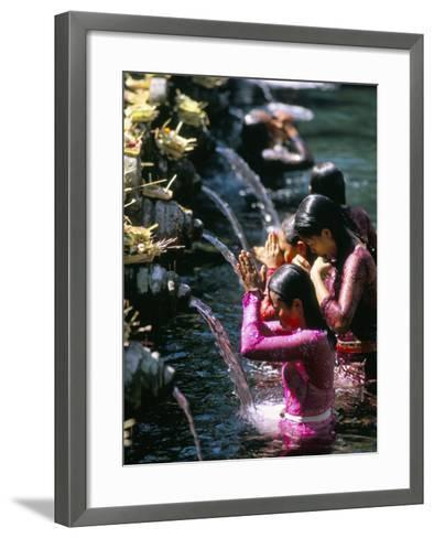 Young Women at Tirta Empul Temple, Ubud Region, Island of Bali, Indonesia, Southeast Asia-Bruno Morandi-Framed Art Print