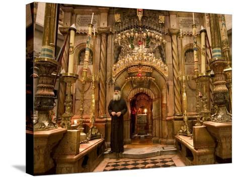 Priest at Tomb of Jesus Christ, Church of Holy Sepulchre, Old Walled City, Jerusalem, Israel-Christian Kober-Stretched Canvas Print