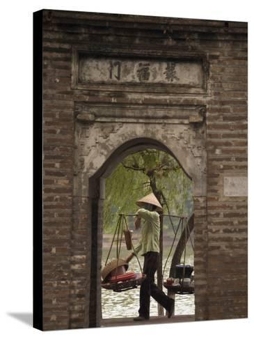 Lady Carrying Baskets, Hoan Kiem Lake, Hanoi, Northern Vietnam, Southeast Asia-Christian Kober-Stretched Canvas Print