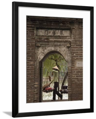 Lady Carrying Baskets, Hoan Kiem Lake, Hanoi, Northern Vietnam, Southeast Asia-Christian Kober-Framed Art Print