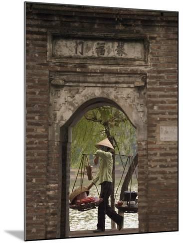 Lady Carrying Baskets, Hoan Kiem Lake, Hanoi, Northern Vietnam, Southeast Asia-Christian Kober-Mounted Photographic Print