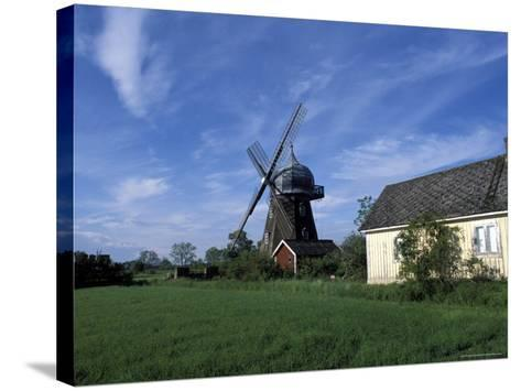 Landscape with Wooden Windmill and Two Houses in the Village of Kvarnbacken, Oland Island, Sweden-Richard Nebesky-Stretched Canvas Print
