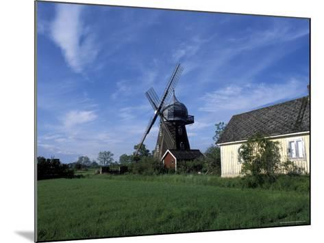 Landscape with Wooden Windmill and Two Houses in the Village of Kvarnbacken, Oland Island, Sweden-Richard Nebesky-Mounted Photographic Print