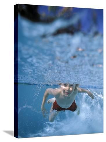 Little Boy Swimming Underwater-James Gritz-Stretched Canvas Print