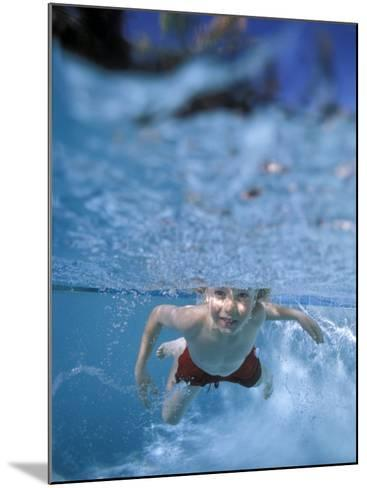 Little Boy Swimming Underwater-James Gritz-Mounted Photographic Print