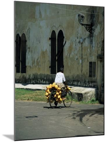Coconut Seller Riding His Bicycle, Galle, Sri Lanka-Yadid Levy-Mounted Photographic Print