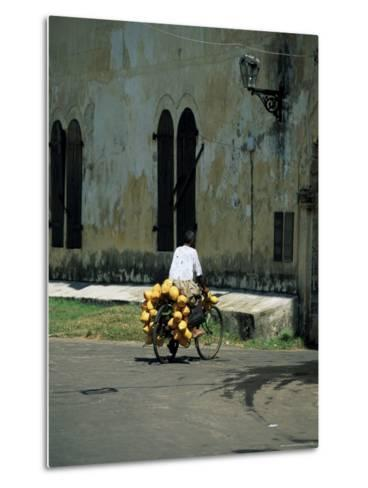 Coconut Seller Riding His Bicycle, Galle, Sri Lanka-Yadid Levy-Metal Print
