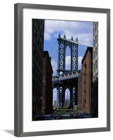 Empire State Building in Distance Seen Through Manhattan Bridge, Brooklyn, New York, USA-Yadid Levy-Framed Art Print