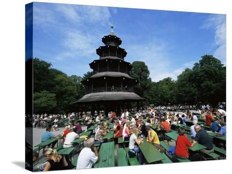 People Sitting at the Chinese Tower Beer Garden in the Englischer Garten, Munich, Bavaria, Germany-Yadid Levy-Stretched Canvas Print
