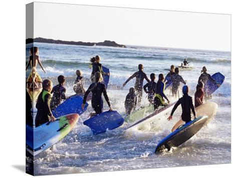 Teenage Surfers Running with Their Boards Towards the Water at a Life Saving Competition-Yadid Levy-Stretched Canvas Print