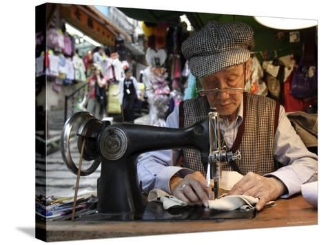 A Tailor at Work in Hong Kong, China-Andrew Mcconnell-Stretched Canvas Print