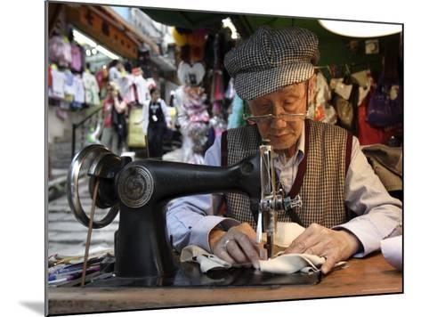 A Tailor at Work in Hong Kong, China-Andrew Mcconnell-Mounted Photographic Print