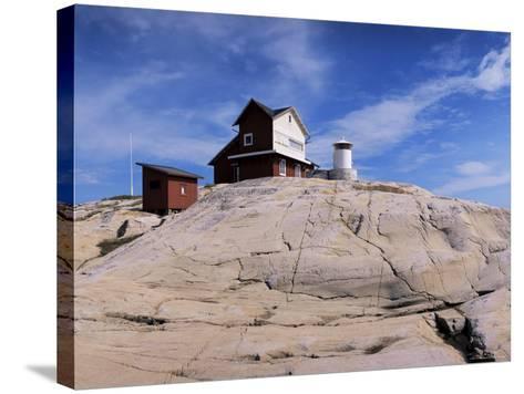The Lighthouse on Stora Svangen, off the Island of Reso, Bohuslan, Sweden, Scandinavia-Kim Hart-Stretched Canvas Print