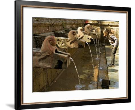 Girl Takes a Drink from the Water Spouts in a Temple Courtyard at Godavari in the Kathmandu Valley-Don Smith-Framed Art Print
