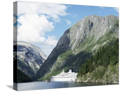 Cruise Ship at Gudvangen, Naeroyfjorden, Unesco World Heritage Site, Western Fiordlands, Norway-Tony Waltham-Stretched Canvas Print