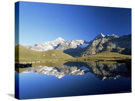 Dent Blanche and Ober Gabelhorn Reflected in Lake, Zermatt, Valais, Switzerland-Ruth Tomlinson-Stretched Canvas Print