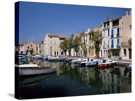 View Across Canal to Colourful Houses, Martigues, Bouches-Du-Rhone, Provence, France-Ruth Tomlinson-Stretched Canvas Print