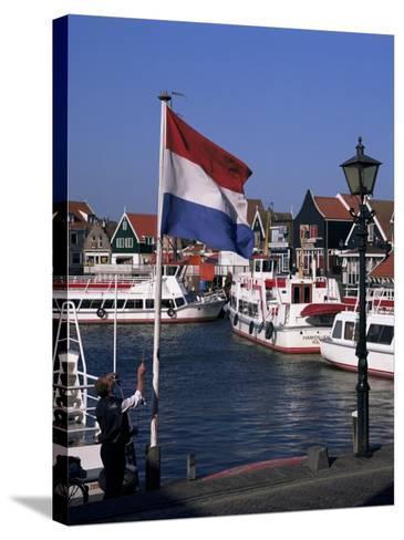 Raising the Dutch Flag by the Harbour, Volendam, Ijsselmeer, Holland-I Vanderharst-Stretched Canvas Print