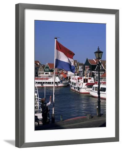 Raising the Dutch Flag by the Harbour, Volendam, Ijsselmeer, Holland-I Vanderharst-Framed Art Print