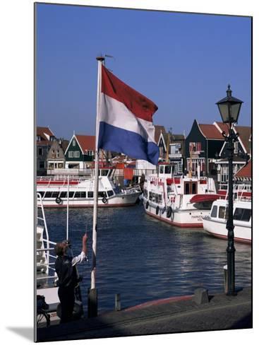 Raising the Dutch Flag by the Harbour, Volendam, Ijsselmeer, Holland-I Vanderharst-Mounted Photographic Print