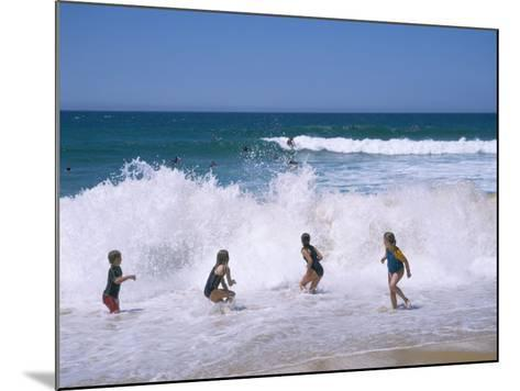 Children Playing in the Surf, Near Gosford, New South Wales, Australia-Ken Wilson-Mounted Photographic Print