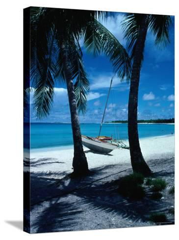 Outrigger Canoe on a Palm-Fringed Beach, Marshall Islands-Oliver Strewe-Stretched Canvas Print