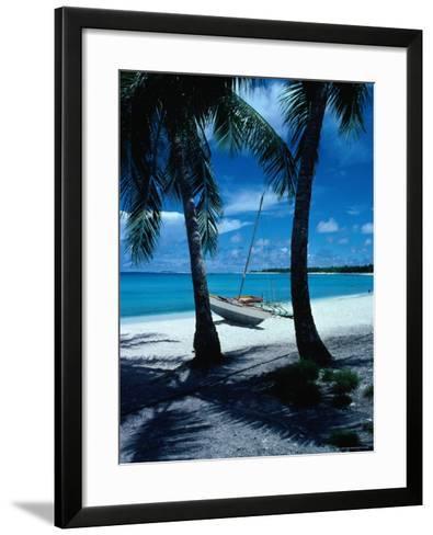 Outrigger Canoe on a Palm-Fringed Beach, Marshall Islands-Oliver Strewe-Framed Art Print