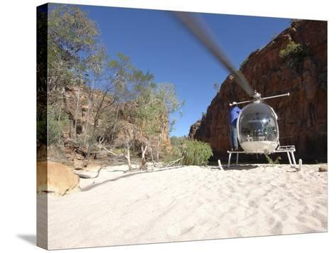 Helicopter on Sand at Bullo River Station, Near Kununurra, Northern Territory, Australia-Michael Gebicki-Stretched Canvas Print