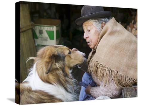 Elderly Female Vendor at Mercado de Los Brujas with Her Dog, La Paz, Bolivia-Brent Winebrenner-Stretched Canvas Print