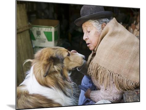 Elderly Female Vendor at Mercado de Los Brujas with Her Dog, La Paz, Bolivia-Brent Winebrenner-Mounted Photographic Print