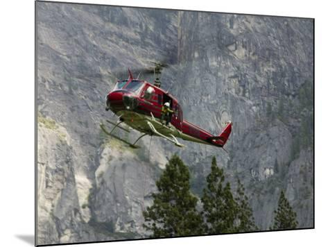 Rescue Helicopter in Front of One of Yosemite Valley's Big Walls-Brent Winebrenner-Mounted Photographic Print