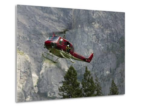 Rescue Helicopter in Front of One of Yosemite Valley's Big Walls-Brent Winebrenner-Metal Print