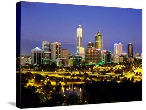 City Skyline with Central Business District at Dusk, Perth, Western Australia-Ross Barnett-Stretched Canvas Print