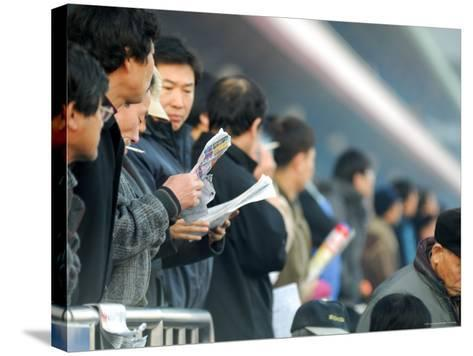 People Studying Form Guide at Seoul Racecourse, Seoul, South Korea-Anthony Plummer-Stretched Canvas Print