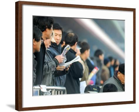 People Studying Form Guide at Seoul Racecourse, Seoul, South Korea-Anthony Plummer-Framed Art Print