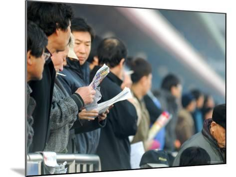 People Studying Form Guide at Seoul Racecourse, Seoul, South Korea-Anthony Plummer-Mounted Photographic Print