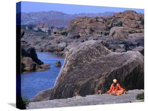 Beggar Shares His Food with Monkeys along the River in Vijayanagar, India-Margie Politzer-Stretched Canvas Print