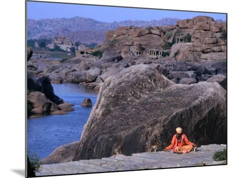 Beggar Shares His Food with Monkeys along the River in Vijayanagar, India-Margie Politzer-Mounted Photographic Print