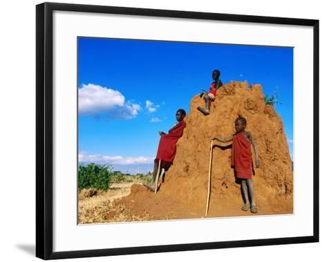 Three Young Maasai Goat Herds on a Termite Mound, Longido, Arusha, Tanzania-Ariadne Van Zandbergen-Framed Art Print