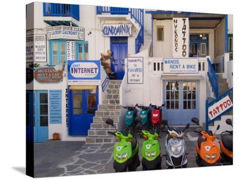 Motorbikes Parked Outside Shops-Diana Mayfield-Stretched Canvas Print