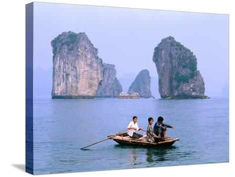 People Fishing in Small Boat with Karsts in Background, Ha Long, Bac Giang, Vietnam-Christopher Groenhout-Stretched Canvas Print