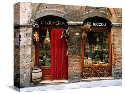 Bicycle Parked Outside Historic Food Store, Siena, Tuscany, Italy-John Elk III-Stretched Canvas Print
