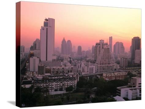 Sunset over City Buildings, Bangkok, Thailand-Stu Smucker-Stretched Canvas Print