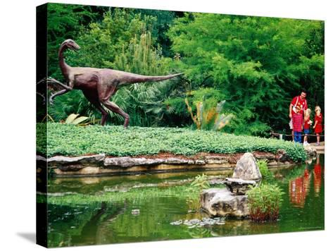 Children and Adult Standing near Ornithomimus Dinosaur Sculpture, Austin, Texas-Richard Cummins-Stretched Canvas Print