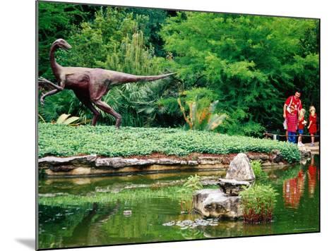 Children and Adult Standing near Ornithomimus Dinosaur Sculpture, Austin, Texas-Richard Cummins-Mounted Photographic Print